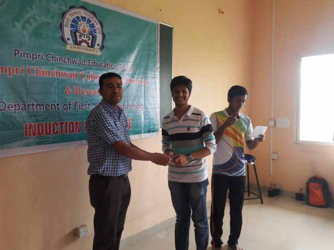 Students have been awarded for doing nice yoga by giving gifts., PCCOER